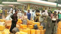 Traders queue at a Filling station due to the lingering fuel scarcity in Lagos