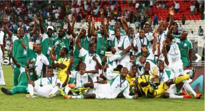 Members of the victorious Nigerian U-17 team pose with their trophies at the Mohamed Bin Zayed Stadium on November 8, 2013 in Abu Dhabi, United Arab Emirates.(Photo: FIFA via Getty Images)